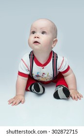 toddler in red pants