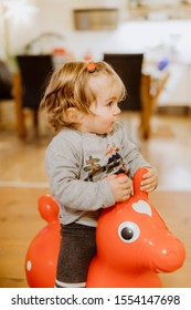 Toddler riding on toy horse – Kempen, Germany