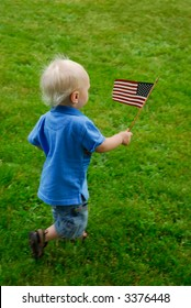 Toddler running around waving an American flag
