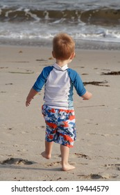 Toddler running at the beach