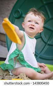 Toddler in the sandpit