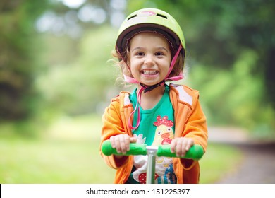 Toddler with a Scooter