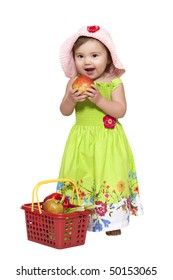 Toddler standing near fruit basket over white