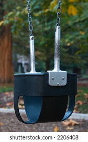 Toddler swing at the park.