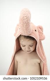 Toddler wearing an elephant bath towel