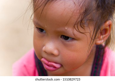 Toddler's Face looking for something and sweaty on her face .