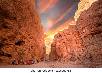Todgha Gorge or Gorges du Toudra is a canyon in High Atlas Mountains near the town of Tinerhir, Morocco . A series of limestone river canyons, or wadi and neighbor of Dades Rivers at sunset