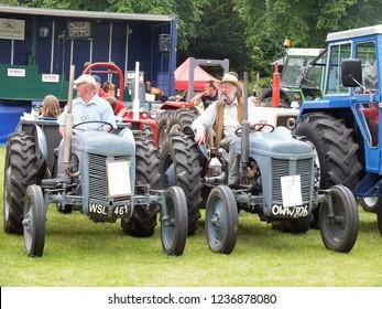 Todmorden, Lancashire, United Kingdom - 17 June 2015: Two men on vintage Massey Ferguson tractors at the annual Todmorden Agricultural Show