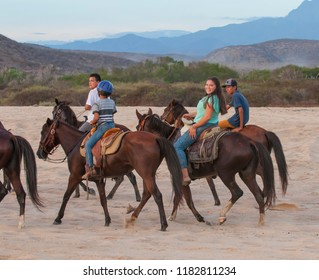 Todos Santos, Baja California Sur/Mexico-Ago 6 2017: Local people riding horses at PUNTA LOBOS Beach
