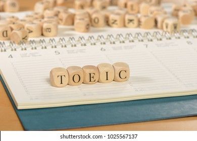 Toeic word on wooden cubes. Toeic concept