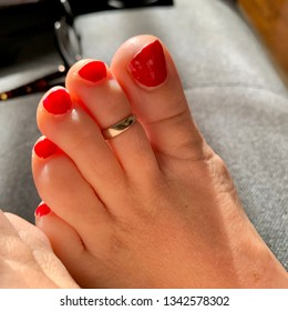 Women's Toes that are painted red