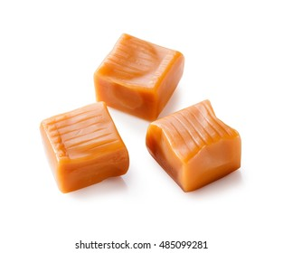 toffee caramel candies close-up isolated on white background (with clipping path)