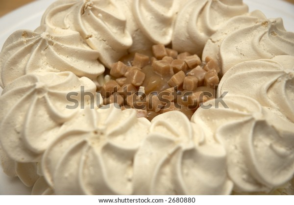 Toffee pavlova on a plate on the table