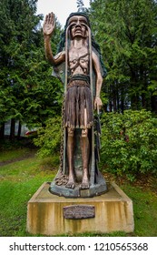"""Tofino, British Columbia, Canada September 22, 2018 - """"Weeping Cedar Woman"""" was carved by artist Godfrey Stephens to aid in the protests against the clear-cut logging on Meares Island in 1984."""
