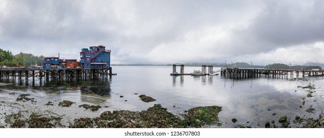 Tofino, British Columbia, Canada September 22, 2019 - Panorama of dramatic clouds & calm water of Cloyoquot Sound with the historic water front Ice House Oyster Bar on a pier at the end of Main Street