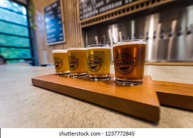 Tofino, British Columbia, Canada, September 20, 2018 - A tasting flight of different beers from local craft brewery, Tofino brewing Company, on Vancouver Island in the touristy  surf town of Tofino