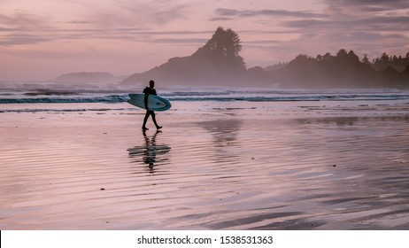 Tofino Vancouver Island Canada September 2019, surfers on the beach of Cox Bay during sunset , a popular surf spot at Tofino