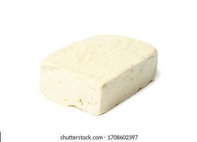 Tofu isolated on a white background, close-up, side view