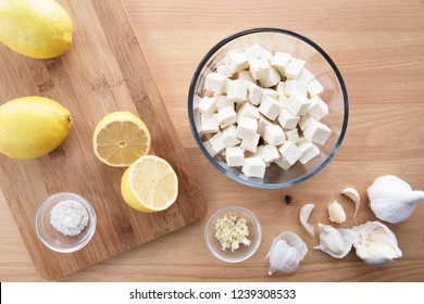 Tofu, lemons, garlic and salt for marinaded tofu  for salads.