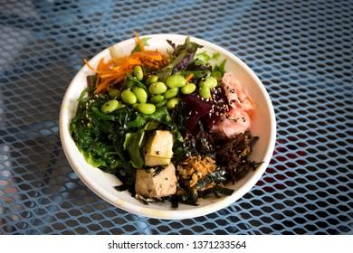 Tofu poke bowl and vegetables
