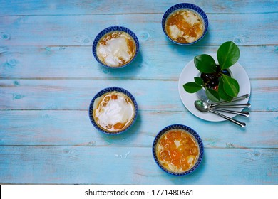 Tofu Pudding with Ginger Syrup and White Tapioca Pearls. This is a favorite dessert in many Asian countries. Top view, with copy space.