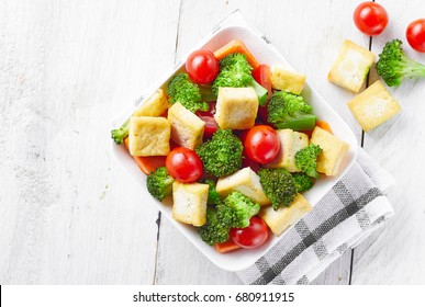 Tofu salad in a white bowl. white background.