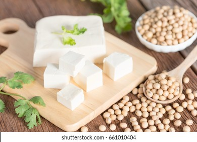 Tofu with soy bean on wooden board.