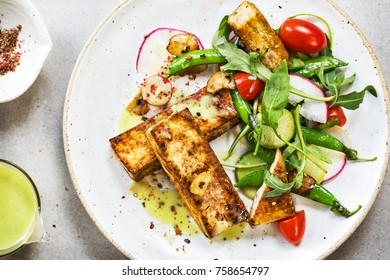Tofu steak with Snow Peas and Rocket Salad with Wasabi cream dressing