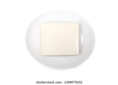 Tofu with white background: Tofu, also known as bean curd, is a food prepared by coagulating soy milk and then pressing the resulting curds into solid white blocks of varying softness.