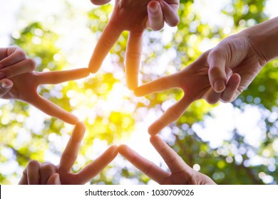 Together Processing hands connecting to star shape, Group of People showing of Diverse Hands Teamwork Concept