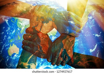 Together strong - Holding hands with earth texture