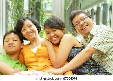 Togetherness of happy Asian ethnic family