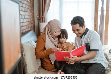 togetherness of a little girl with her parents when a fairy-tale book was read out in bed