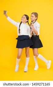 togetherness. online education. knowledge day. happy friends with smartphone. kids make selfie photo, friendship. small girls in school uniform. back to school. educational blog. digital technology.