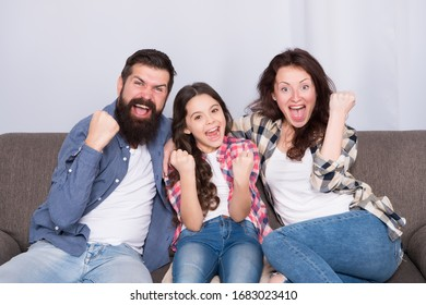 Togetherness is our power. Weekend finally. Little girl relaxing with parents. Stay at home. Family sit on couch. Happy father mother and daughter. Quarantine and isolation concept. Smiling family.