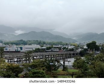 Togetsu-kyo Bridge and Katsura River in the cloudy morning. Arashiyama, Kyoto, Japan.