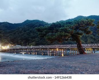 Togetsu-kyo Bridge and Katsura River at dusk, Arashiyama, Kyoto, Japan.