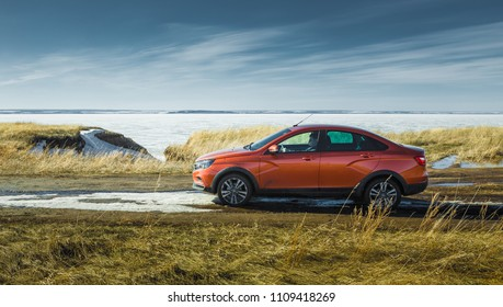 Togliatti, Russia, APRIL 10, 2018: Presentation of the new LADA Vesta cross sedan. Spring off-road car tests in water and roadless conditions on ordinary Russian country bad roads