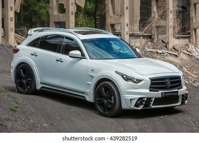 Togliatti, RUSSIA June 11: INFINITY QX70 with tuning kit LR3 of LARTE Design Tuning Company. Dump outside the city and Industrial background. Test Drive on June 11, 2013 in Togliatti, RUSSIA