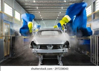 TOGLIATTI, RUSSIA - NOVEMBER 14: Paint Shop. Robots painting car body of LADA Cars in Automobile Factory AVTOVAZ on November 14, 2013 in Togliatti