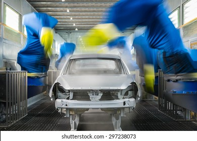 TOGLIATTI, RUSSIA - NOVEMBER 14: Paint Shop. Robots painting car body of LADA Cars in Automobile Factory AVTOVAZ on November 14, 2013 in Togliatti