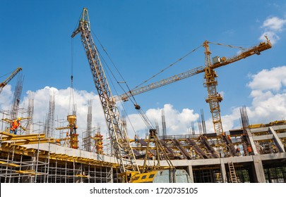 Togliatti, Samara Oblast / Russia - June 30, 2011: Panorama of the construction site of the hockey arena with cranes, special mechanisms and various of construction equipment. Formwork and foundation