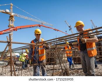 Togliatti, Samara Oblast / Russia - May 24, 2011: Portrait of construction workers who build the objects in construction sites with a different construction equipment