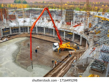 Togliatti, Samara Oblast / Russia - October 12, 2011: Panorama of construction site. Concrete pump convey concrete on reinforcement flor of ice hockey arena