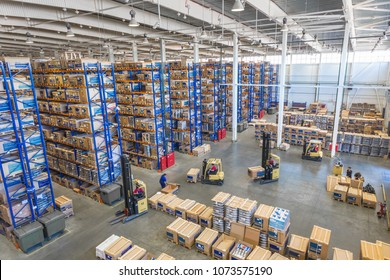 TOGLIATTI, SAMARA region, RUSSIA - APRIL 09, 2013: Interior of LADA auto parts warehouse. Large modern LADA-IMAGE warehouse with forklifts for storage vehicle spare parts. Biggest stock in RUSSIA