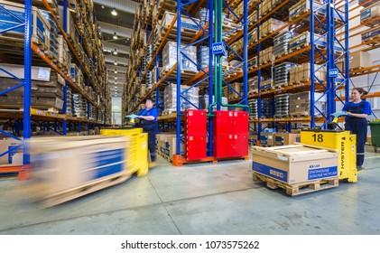TOGLIATTI, SAMARA region, RUSSIA - APRIL 09, 2013: Interior of LADA auto parts warehouse. Large modern LADA-IMAGE warehouse with forklifts for storage vehicle spare parts. Biggest stock in RUSSIA