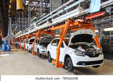 Togliatti, Samara / Russia  – 08.16,2017: AutoVAZ - Volzhsky Automobile Plant, largest car manufacturer in Russia and Eastern Europe. Assembling cars (Lada and Renault) at conveyor assembly line.