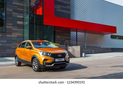 TOGLIATTI, SAMARA / RUSSIA - SEPTEMBER 14, 2018: LADA XRAY Cross. Presentation the new vehicle production of AVTOVAZ. Prestigious off-road car in the city of Togliatti. Modern buildings on background
