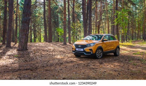 TOGLIATTI, SAMARA / RUSSIA - SEPTEMBER 14, 2018: LADA XRAY Cross. Presentation the new vehicle production of AVTOVAZ. Off-road car on the bank of VOLGA-river with sand, water, and roadless conditions