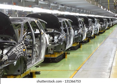 "TOGLIATTI - SEPTEMBER 30: Row of new bodies for Lada Kalina at Avtovaz factory on September 30, 2011 in Togliatti, Russia. AvtoVAZ won contest ""Best Russian Exporter of 2011"" in category Cars."